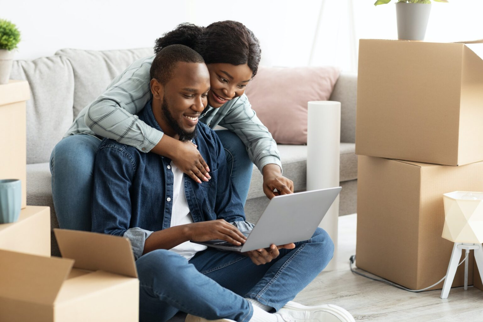 Online Order. Happy Young Black Couple With Laptop Choosing Furniture In Internet