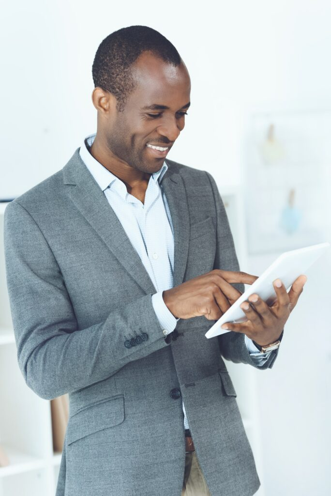 smiling african american man using tablet